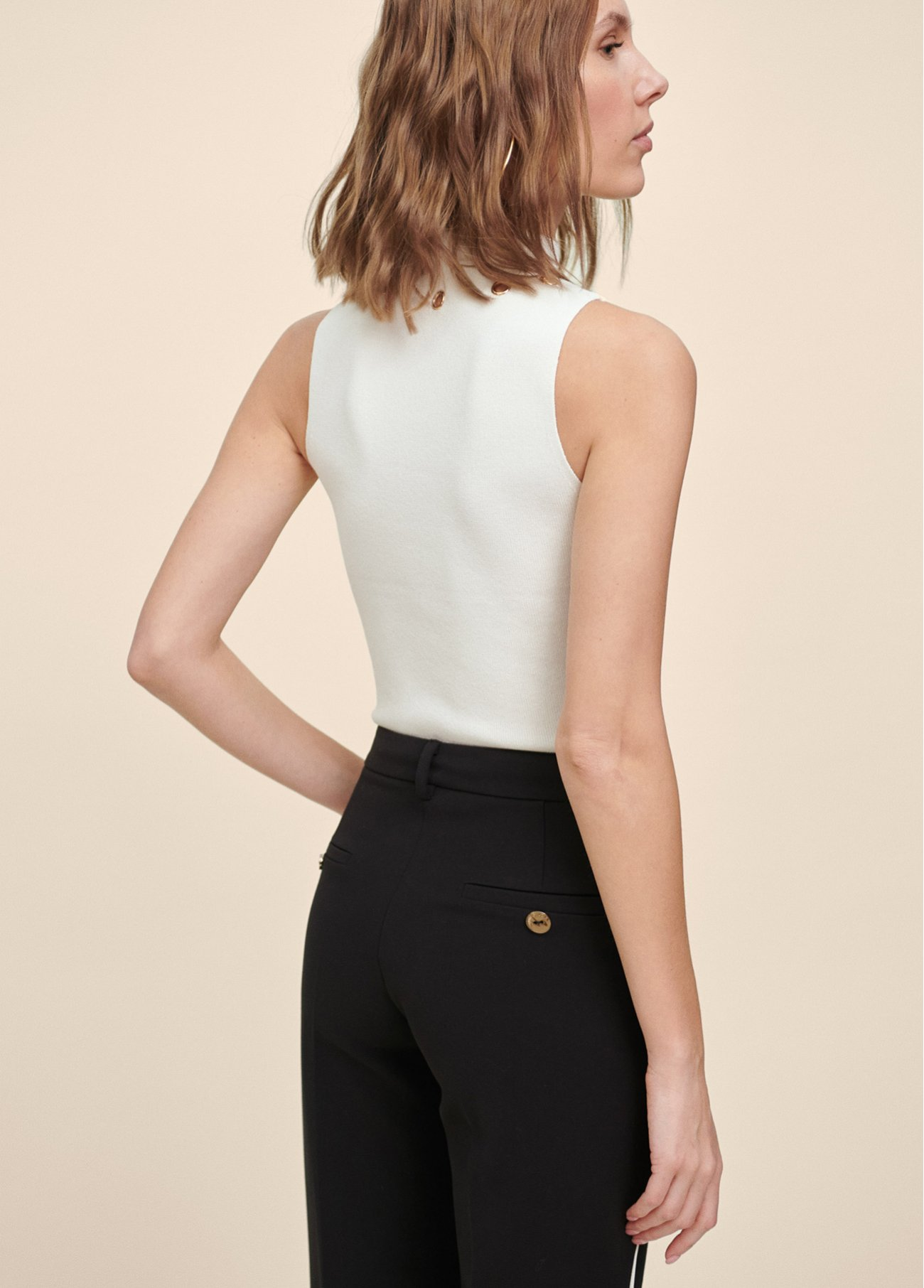 Sleeveless top with golden ring details