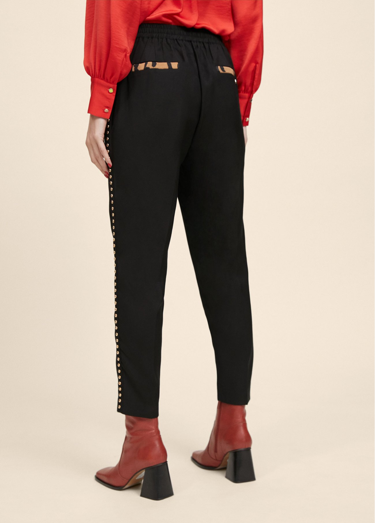 Black trousers with gold-toned studs