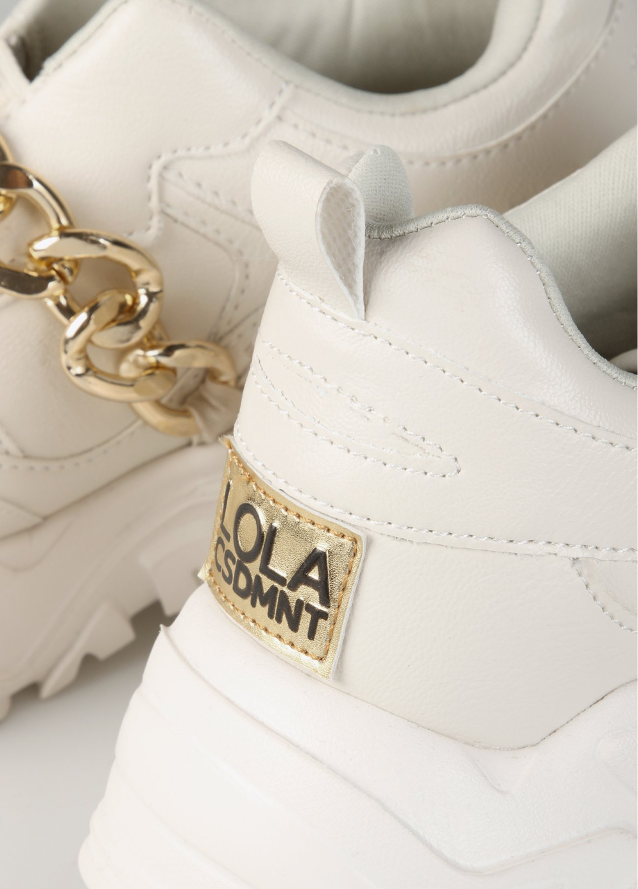Off-white sneaker with gold chain decora