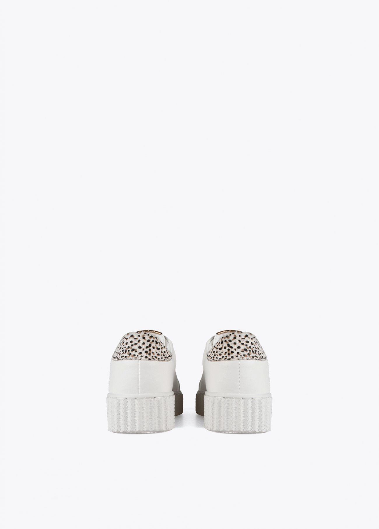White sneaker with leopard patch