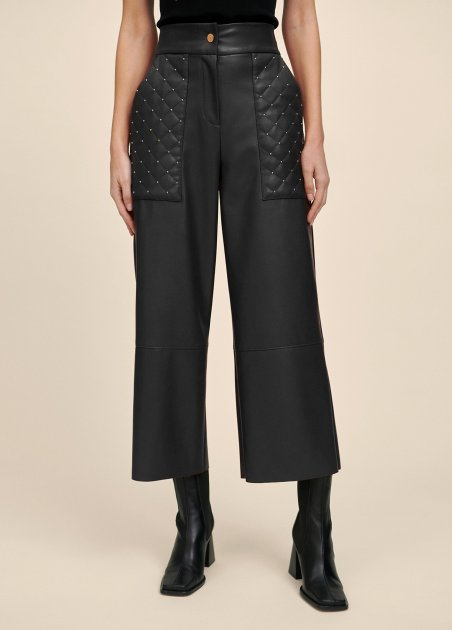 Faux leather trousers with...