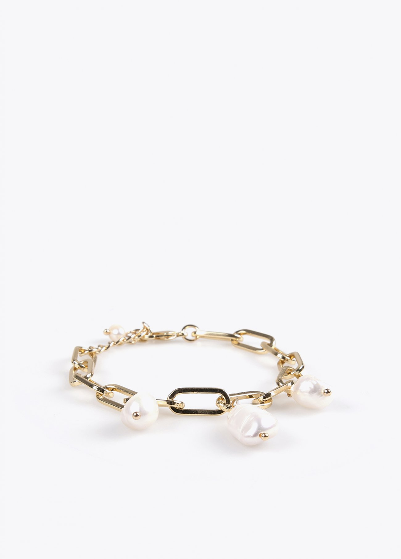 Golden bracelet with faux pearls
