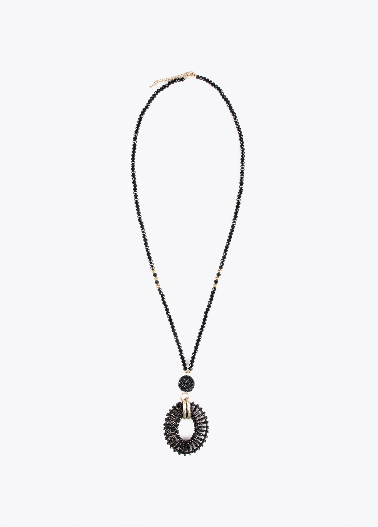 Long necklace with circular pendant