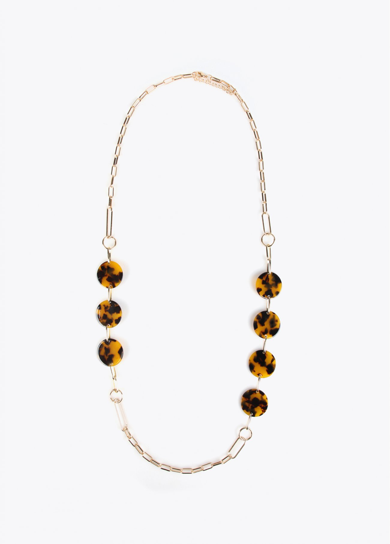 Long golden necklace with resin